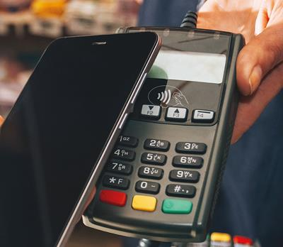Phone making contactless payment Compliance Audit Of Specific Online Payment Method