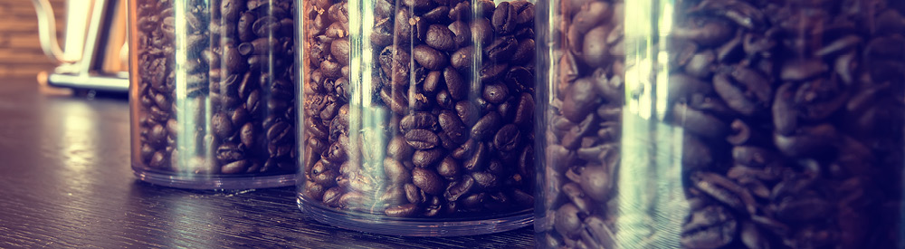 Coffee beans in jars on a shelf for a retail shelf audit