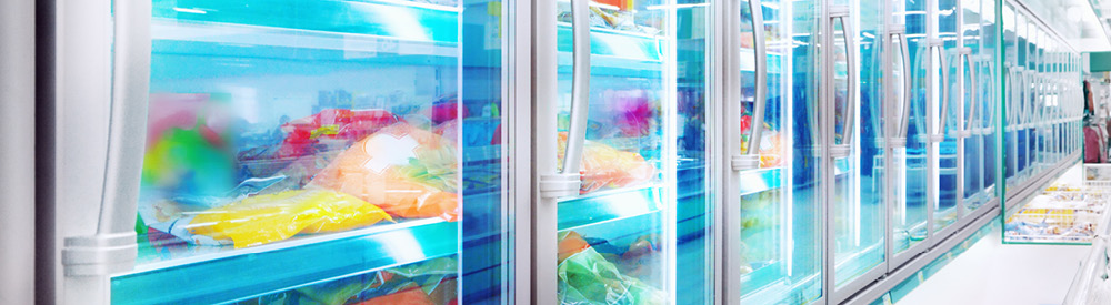 A row of freezers with frozen food in that have just been filled after a store remodel