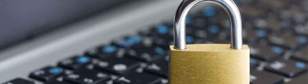 Padlock in front of a computer depicting retail cyber crime