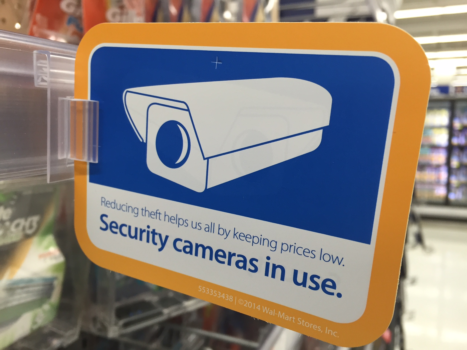 A security camera sign depicting risk n the retail environment