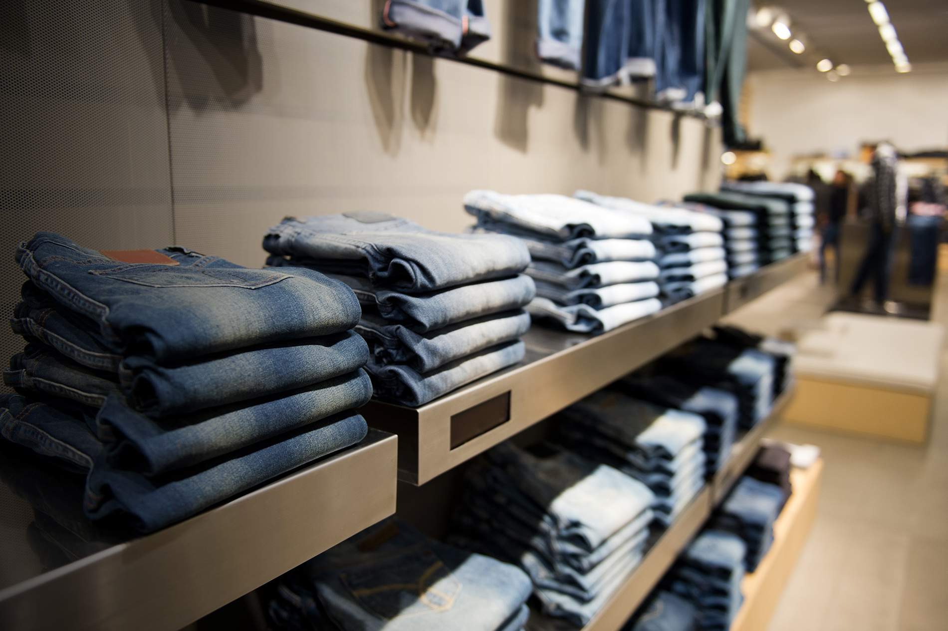 retail store with jeans on a shelf