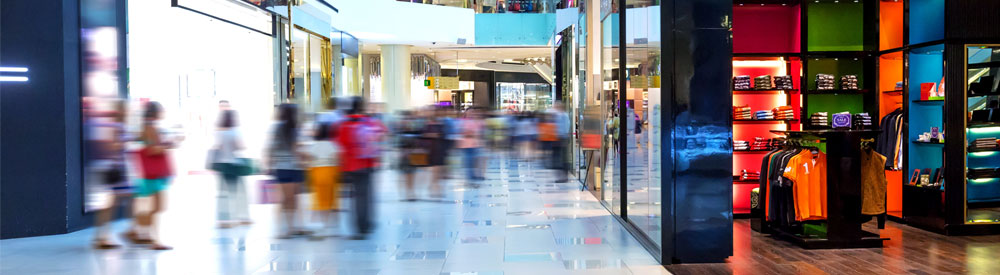 Shoppers in a retail shopping centre and a link to download RGIS retail stocktaking solutions